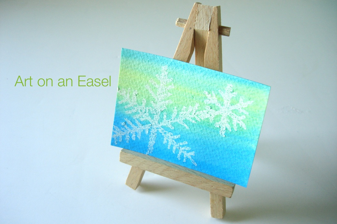DIY Watercolor snowflake art on easel • Shannon Christensen